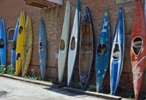 kayaks against the wall