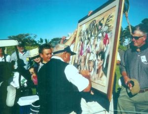 Arnold Palmer signs painting